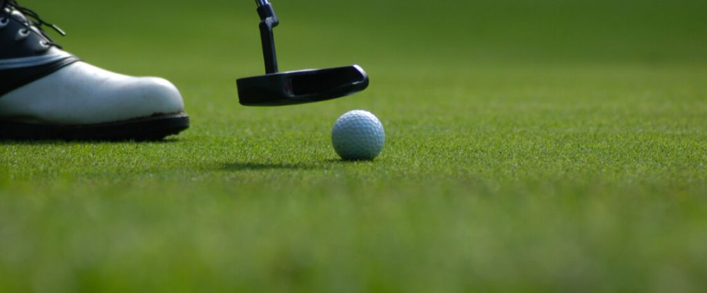 golf ball on the green, putting in scotland