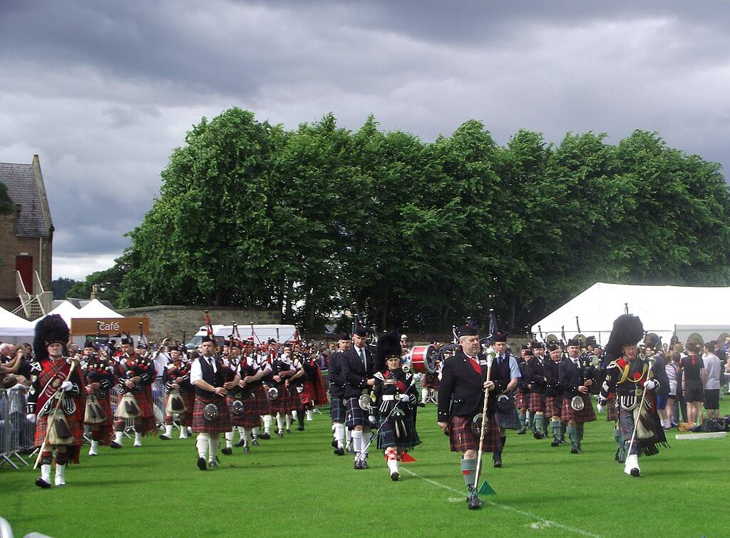 Highland Games large group of Scottish musicians, pipe band players